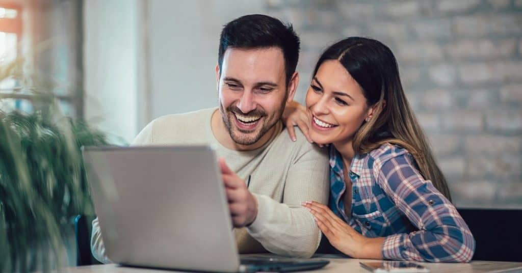 Couple spending quality time at home planning a vacation