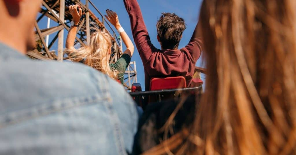 Couple on a rollercoaster: a fun physical touch date.