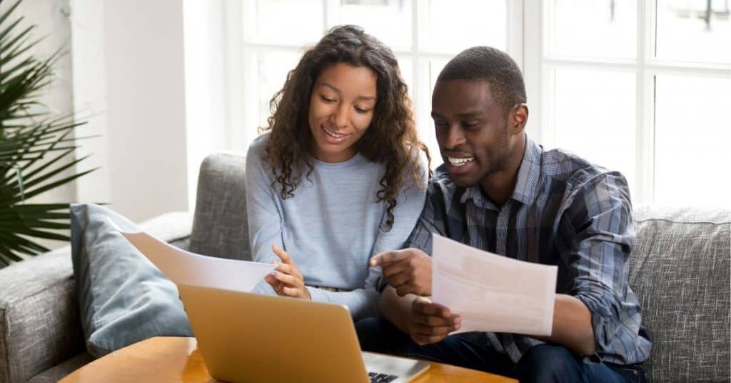 Couple budgeting together (one of the tips for a happy marriage).