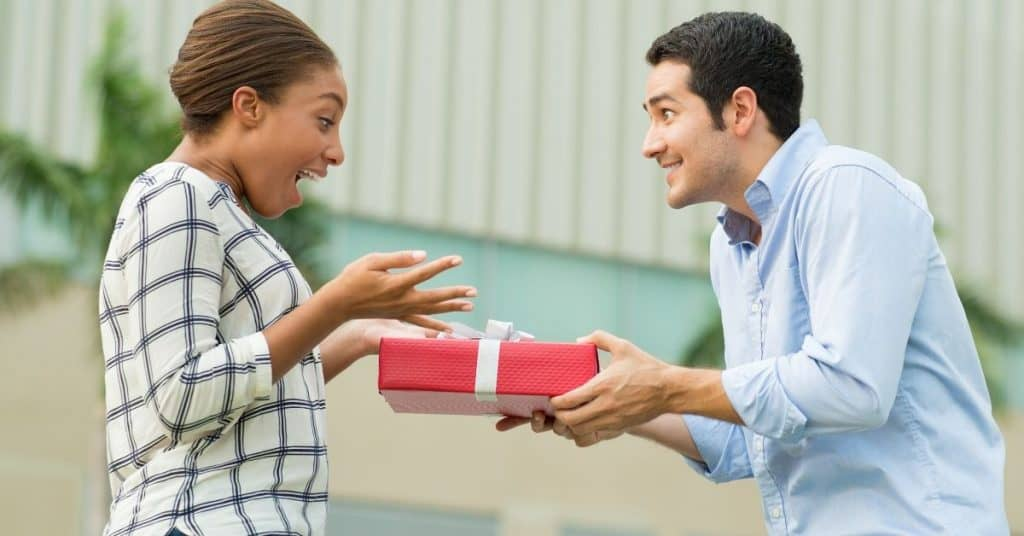 Man giving his partner a gift.