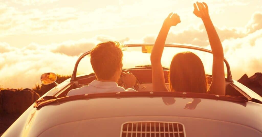 Couple on a Sunday drive in a convertible
