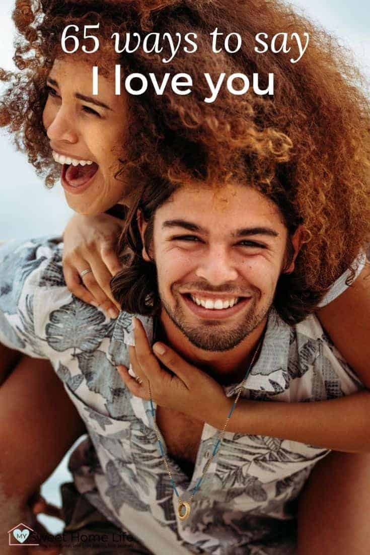 """A laughing couple with the text overlay, """"65 ways to say I love you"""""""