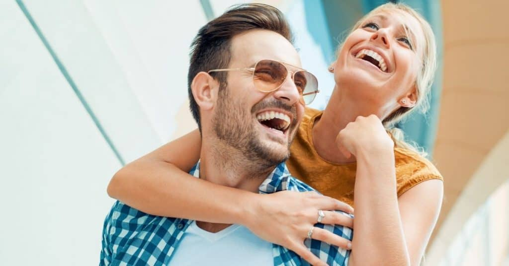 Couple laughing, enjoying some quality time activities for couples.