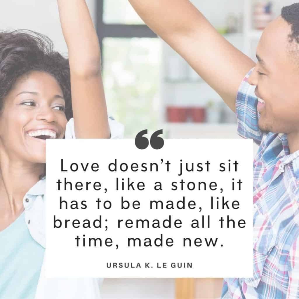Black couple dancing in kitchen in the background with the text of an Ursula K L Guin troubled marriage quotes