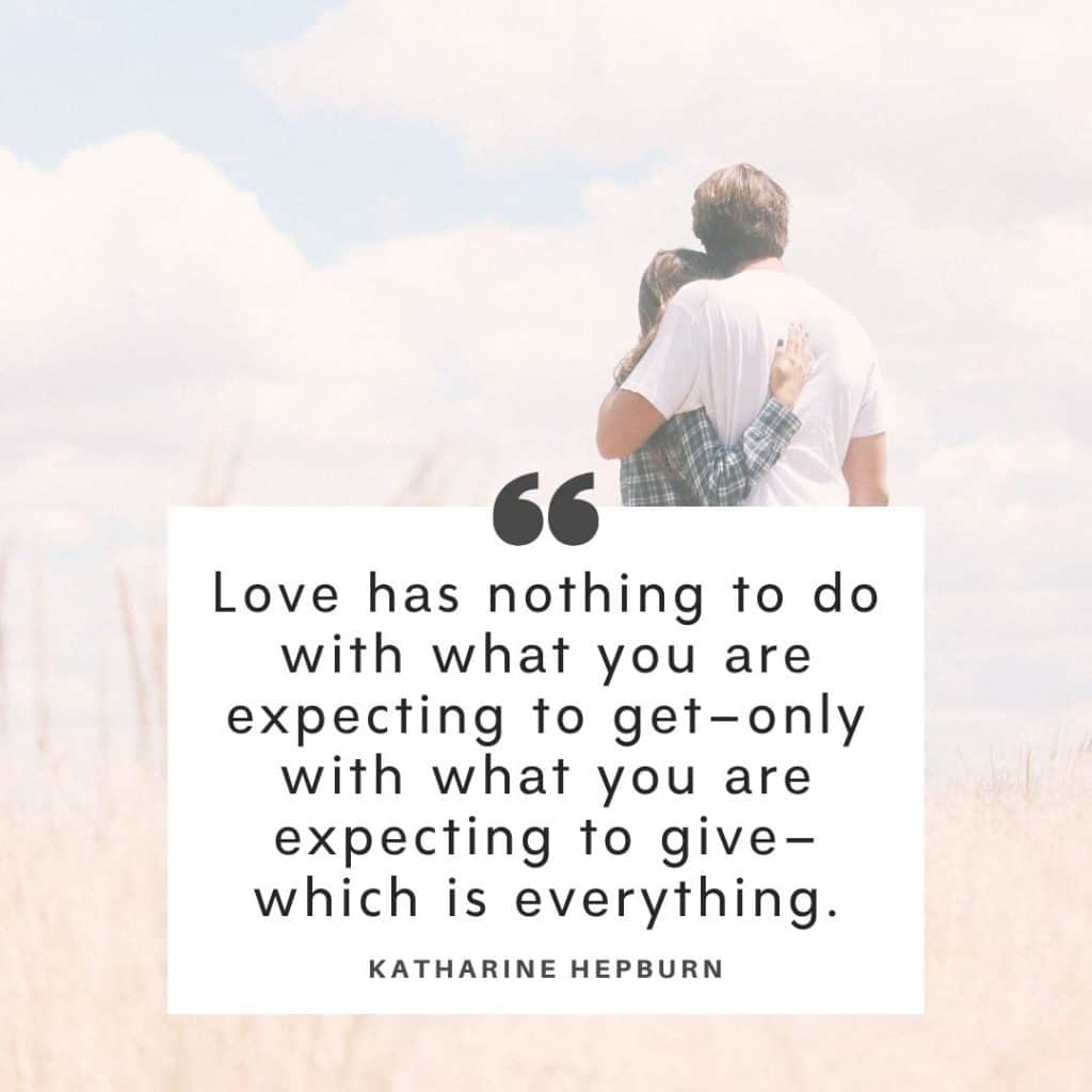 Text of one of the getting through hard times in marriage quotes by Katharine Hepburn The background image is of a couple standing in a field with their backs to the camera and soft light all around.