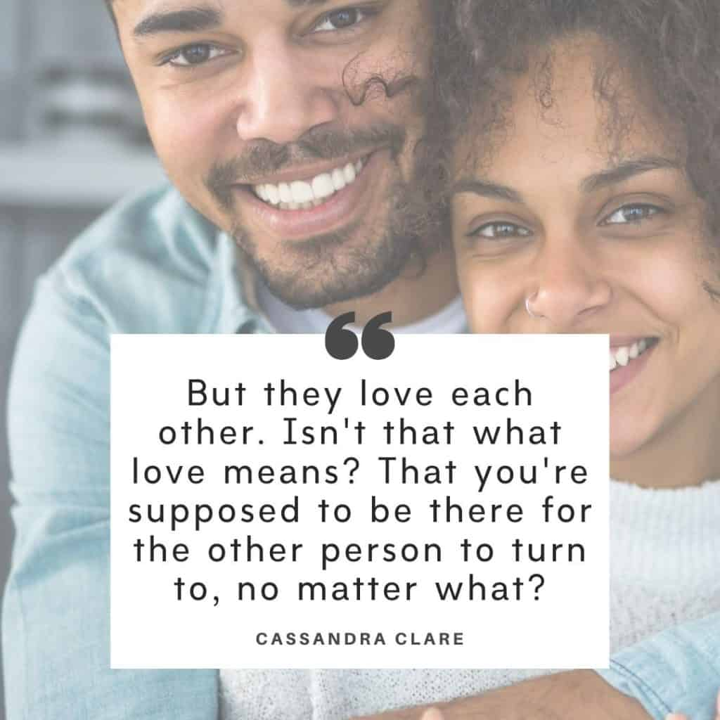 A black couple holding each other with a marriage is hard quotes overlay by Cassandra Clare.