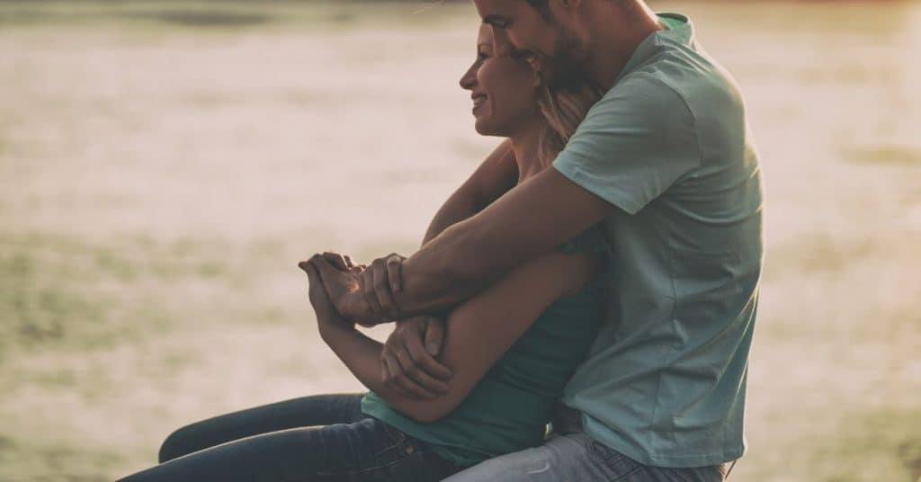 couple hugging after marriage therapy - experiencing some success after these marriage therapy tips.