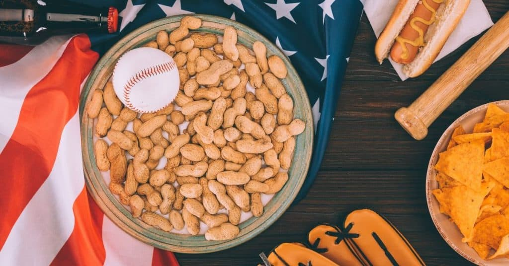 American flag, nuts, baseball glove and ball: going to a sports game is one of the mother son date ideas
