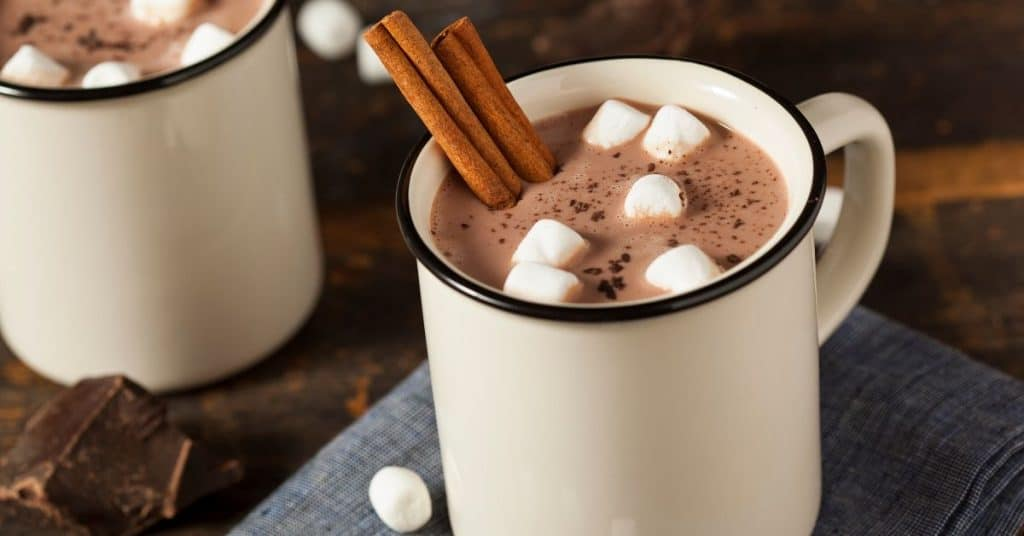 Two glasses of hot chocolate: date ideas for rainy days