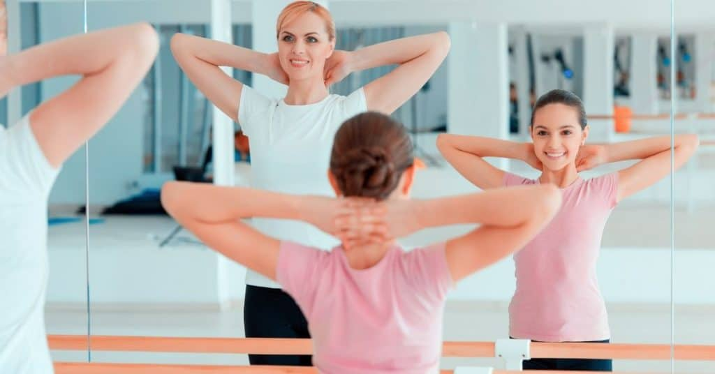 Mom and daughter at dance class together: one of the mom and daughter date ideas
