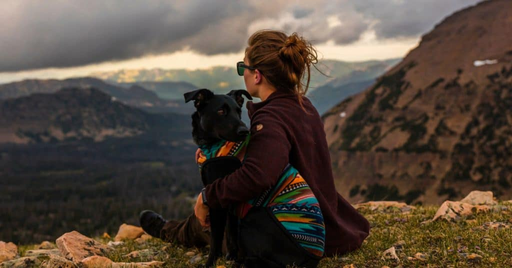 dog mom with her dog on a mountain