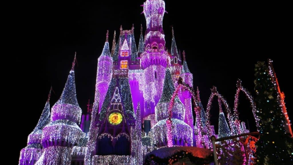 Disney Castle lit up with purple lights: the perfect place for a fun weekend getaway from Los Angeles.