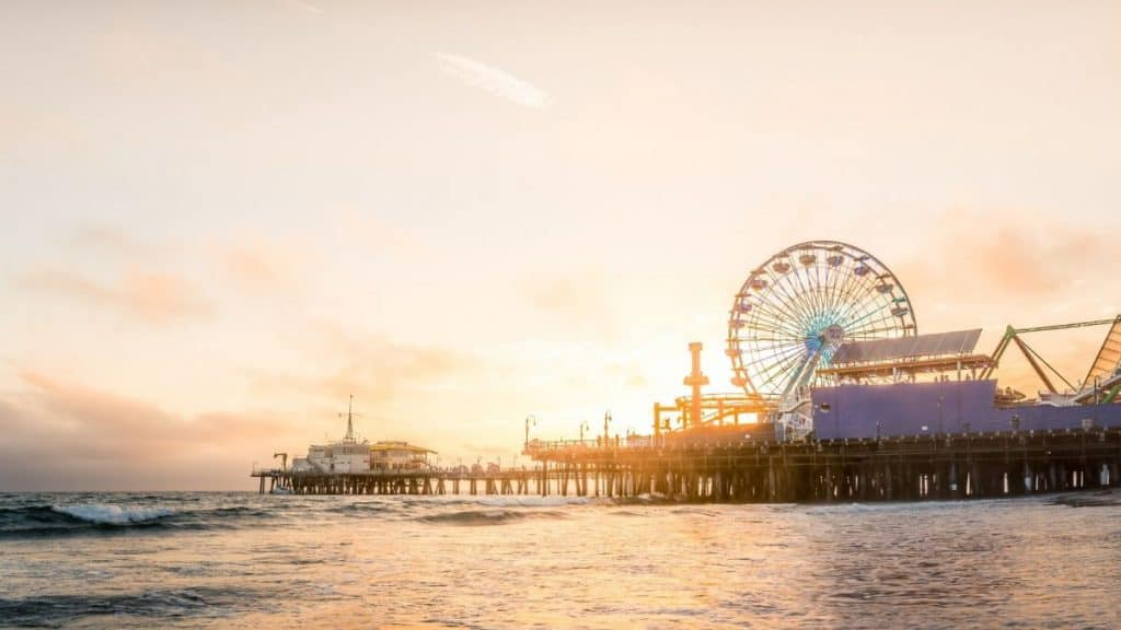 Santa Monica pier at sunset: a great place to visit when having a fun weekend getaway from Los Angeles.