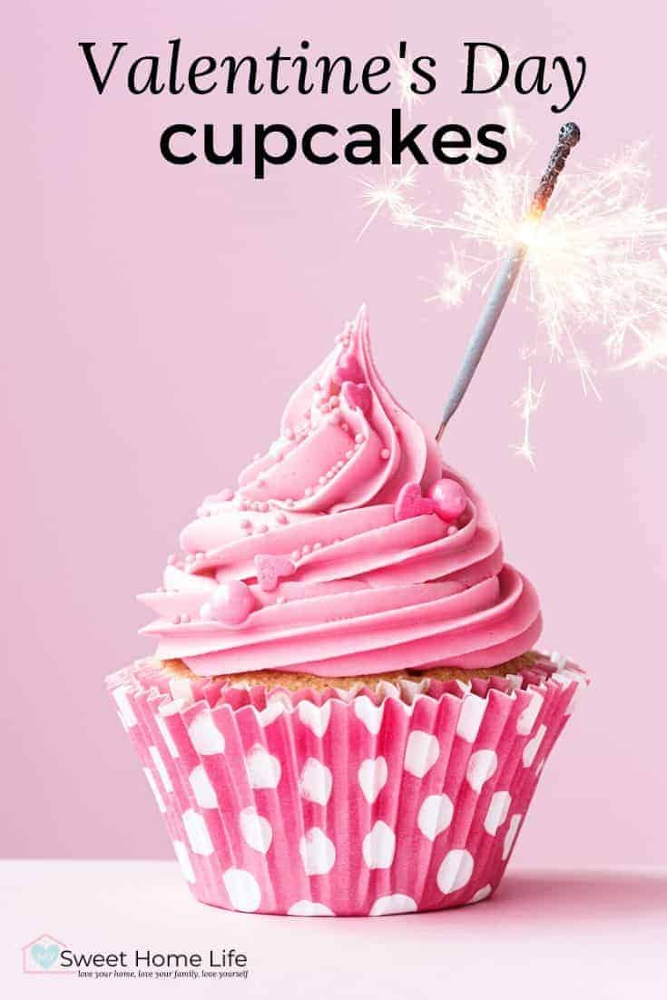 A pink cupcake with a sparkler in it and the text overlay, Valentine's Day cupcakes.