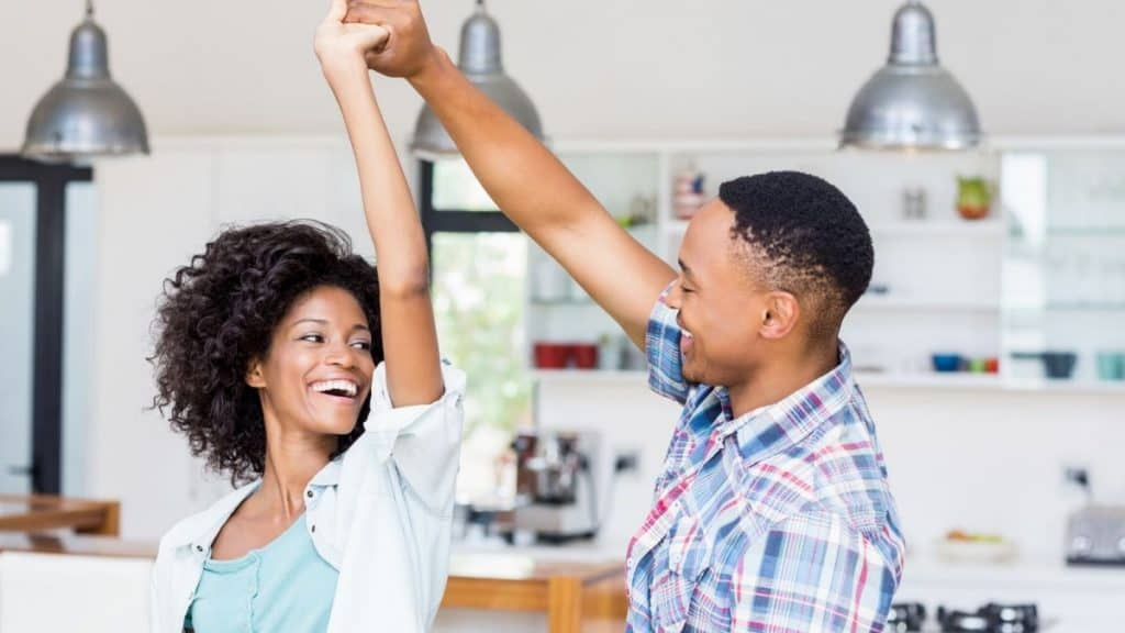 Couple dancing in the kitchen.
