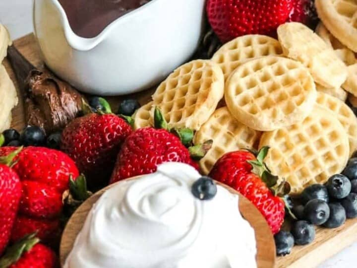 a view of the waffle board with a bowl of cream in the foreground.