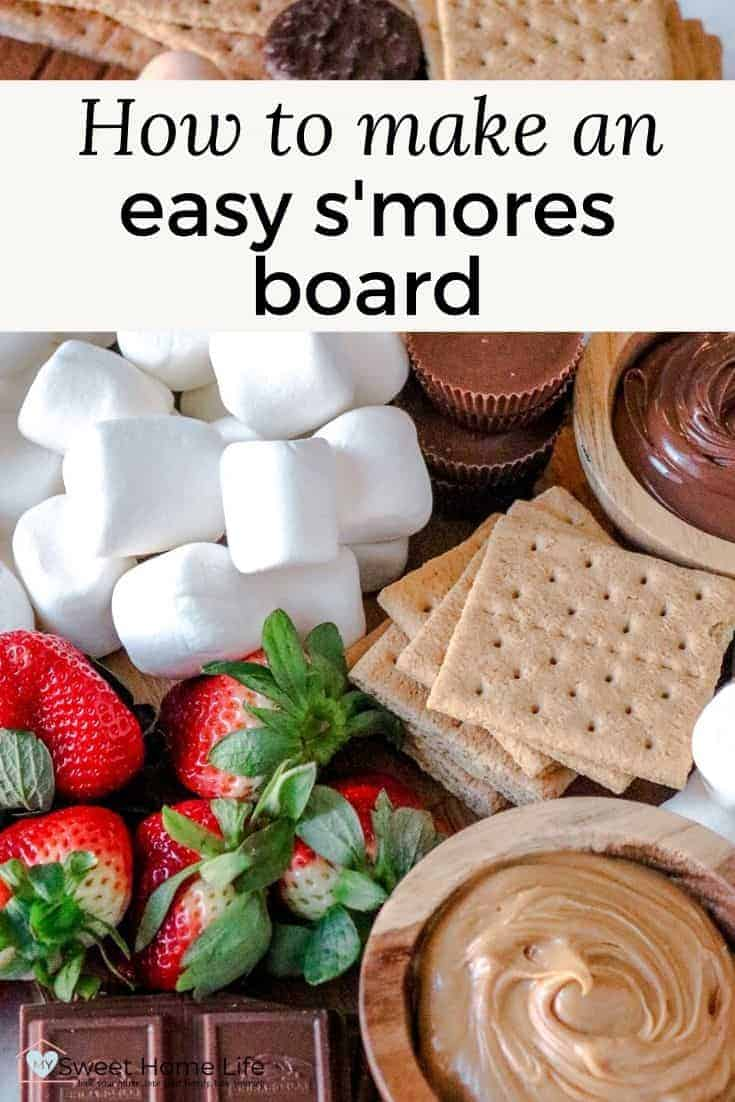 Ingredients for a smores board including crackers, strawberries and marshmallows with the text overlay How to make an easy smores board.