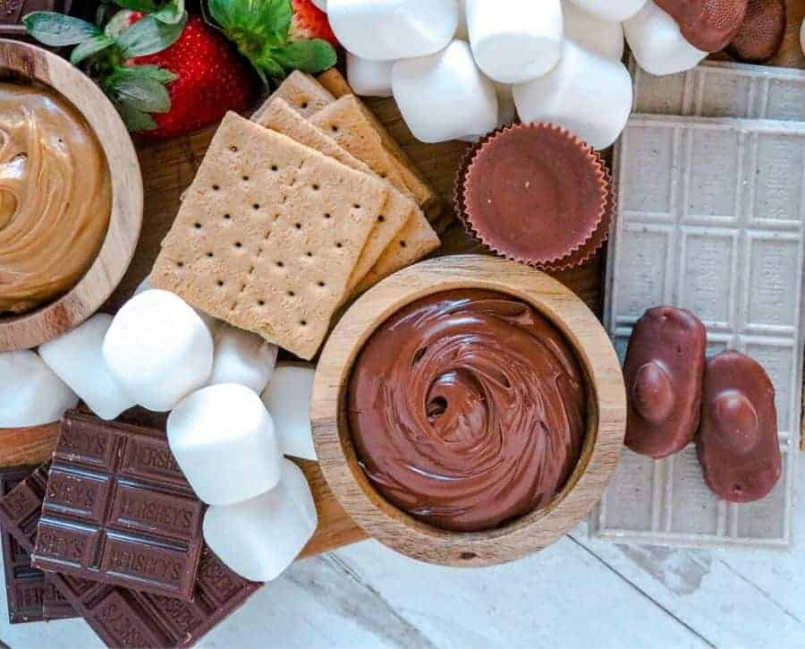 A smores board where you can see how to place the nutella and peanut butter.