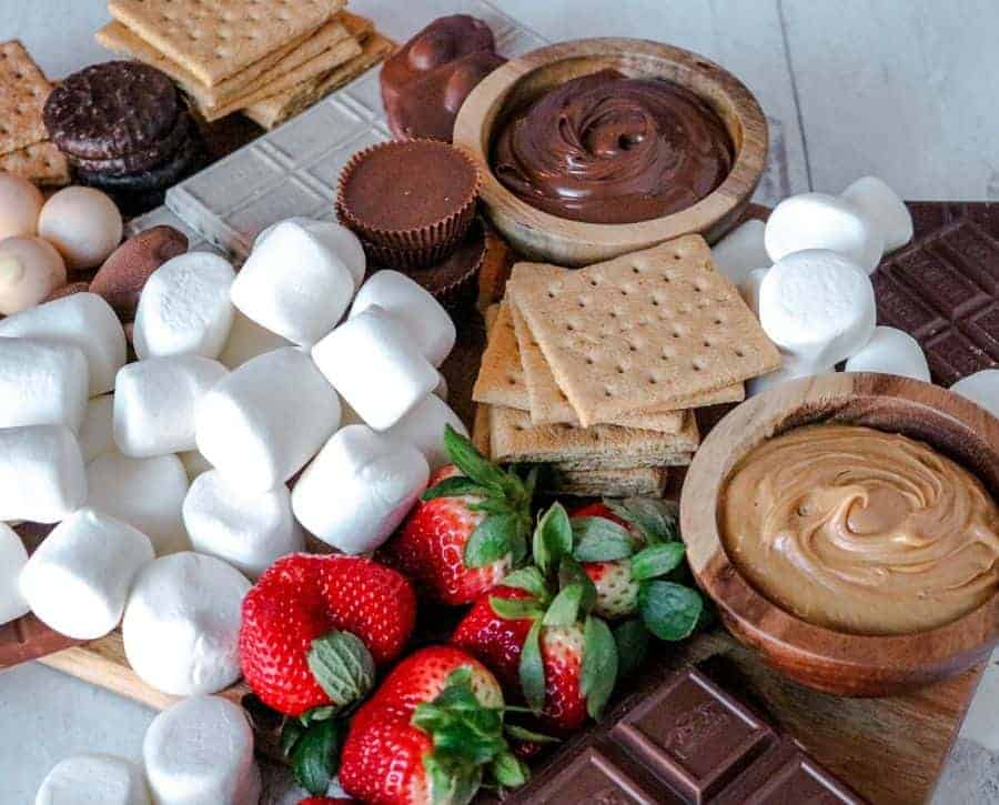 A s'mores board where you can see the piles of graham crackers.