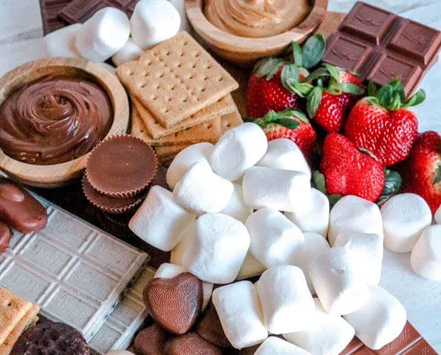 A s'mores board where you can see the big blocks of chocolate.