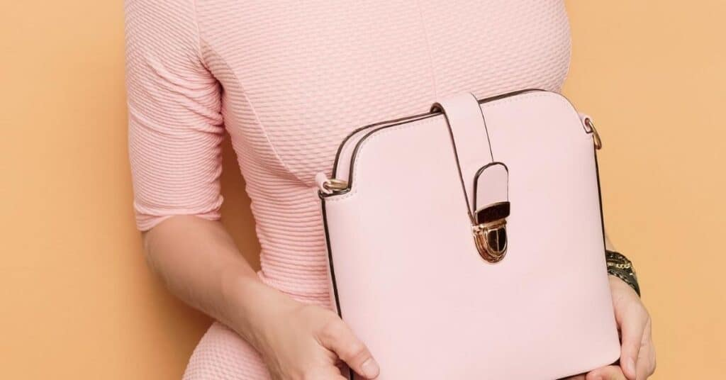 Woman in pink top holding pink Chanel handbag