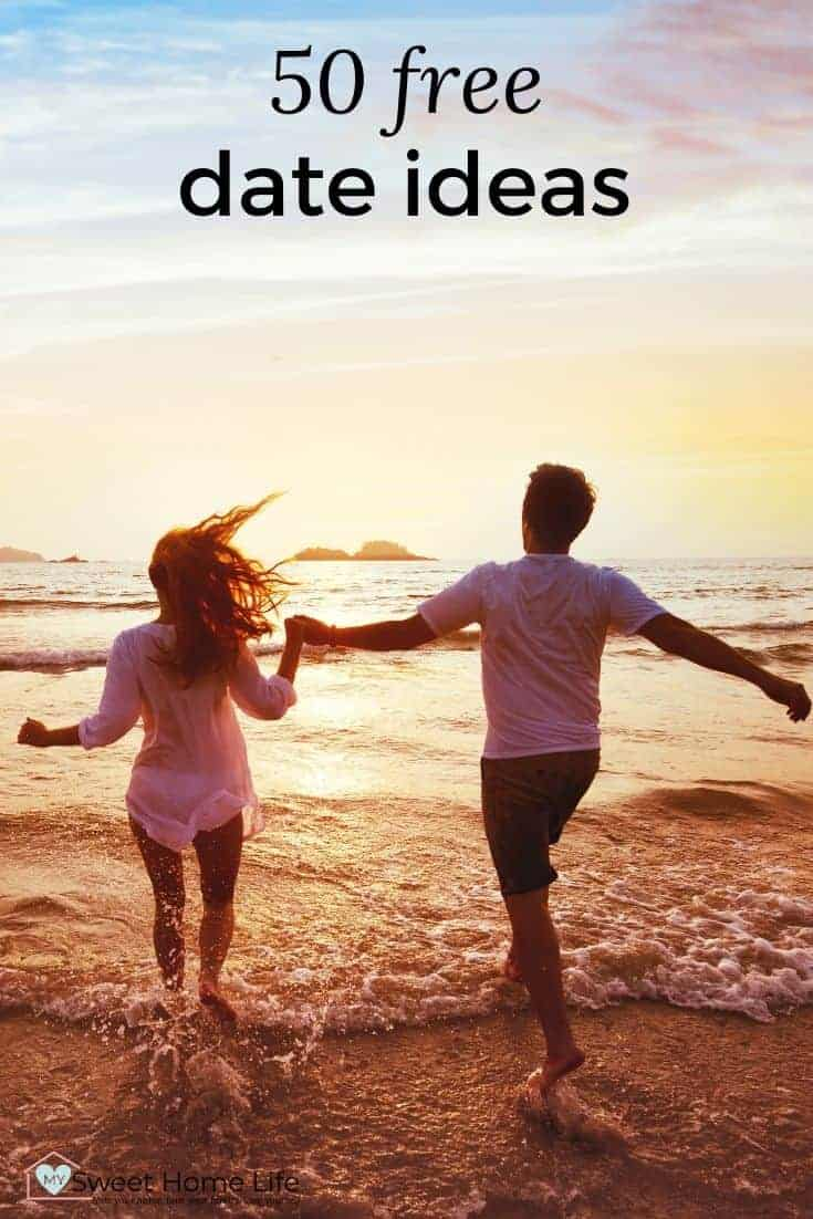 Couple hand in hand in the sea with the text overlay, 50 free date ideas.