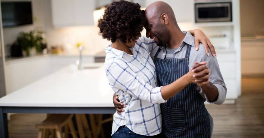 A black couple slow dancing at home: one of the romantic date night ideas