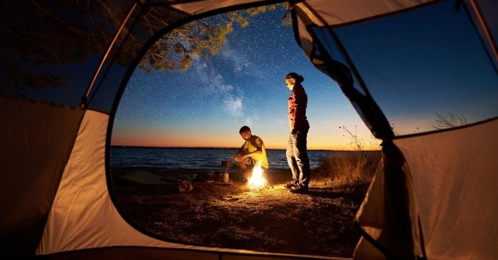 Couple outside their tent.