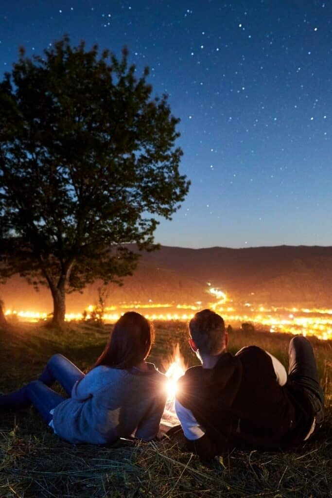 A couple lying on their backs watching the stars.